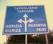 220px-Road_sign_in_Friulian (1)