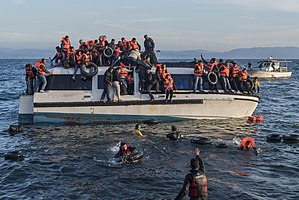 300px-20151030_Syrians_and_Iraq_refugees_arrive_at_Skala_Sykamias_Lesvos_Greece_2